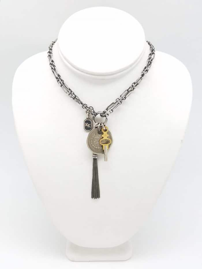 Victorian style chain necklace with Filenes of Boston credit token with pocket watch key and tassel