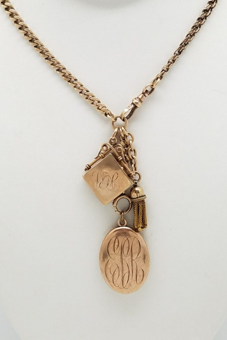 Gold Pocket watch chain with Lockets and tassel.